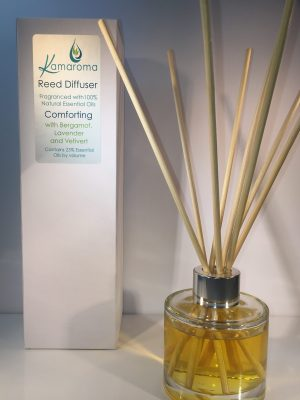 Reed Diffuser with blend of essential oils to give comfort and reassurance pictured with rattan reeds inside the bottle with box in background.