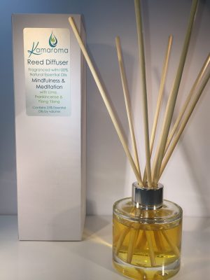 Reed Diffuser with blend of essential oils to bring you into a state of mindfulness and ready for meditation pictured with rattan reeds inside the bottle with box in background.